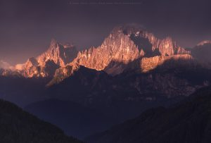 Intense evening light striking Mt Civetta in Italy