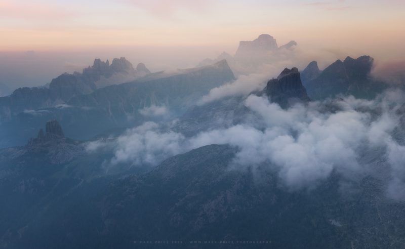 Late afternoon low cloud over the peaks of the Cortina region, Italy