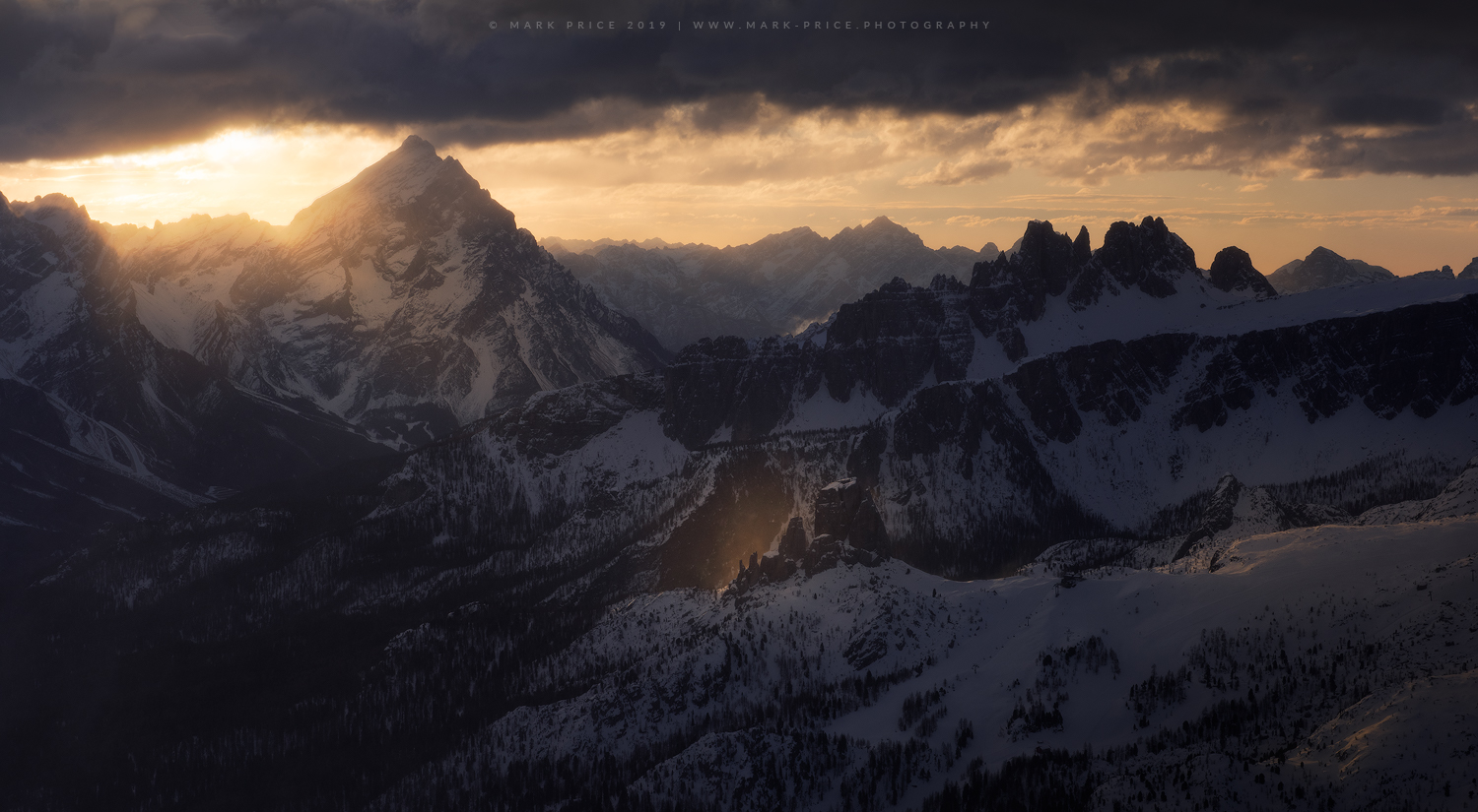 Early morning light cascading across Monte Civetta, and the Cinque Torri, Dolomites, Italy