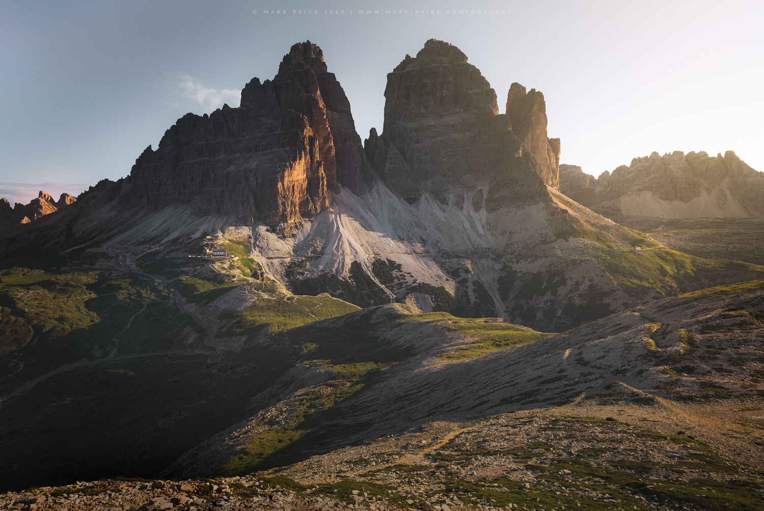 Golden morning light illuminates the south faces of Tre Cime Di Lavaredo