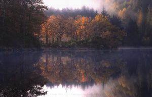 Autumn in full flow at a quiet Scottish loch