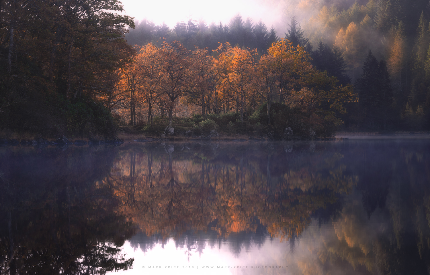 Autumn in full flow at a quiet Scottish loch