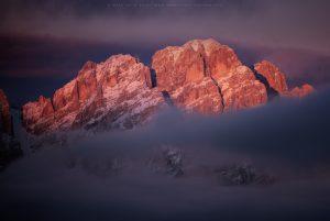 Evening light illuminates a peak above Cortina D'Ampezzo in Italy