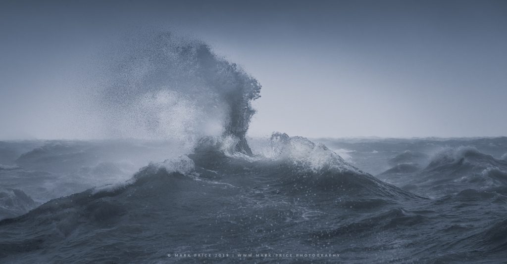 Waves bouncing off a harbour wall swell into the sky during a Sussex storm