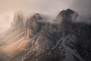 A trio of huge peaks catch dynamic sidelight, Dolomites