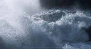 A torrent of storm driven water crashes into the coastline in Dorset, England