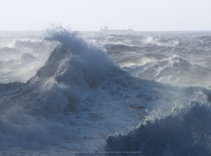 Storm Waves crash in the water off the Sussex coast in winter