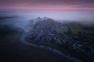 An early summer morning over Bramber in the mist, West Sussex