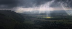 A panoramic view of dynamic light across Devil's Dyke, Sussex