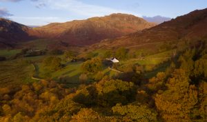 First golden light cast over a valley in the Lake District
