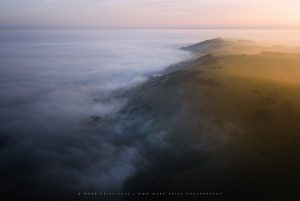Astonishing fog cover and light over Ditchling Beacon, Sussex