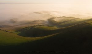 Magnificent fog and light across the rolling hills of the South Downs, Sussex