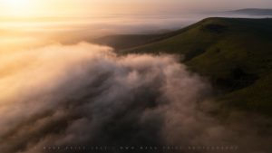 Rolling fog and cloud pushes over the peaks of the South Downs National Park