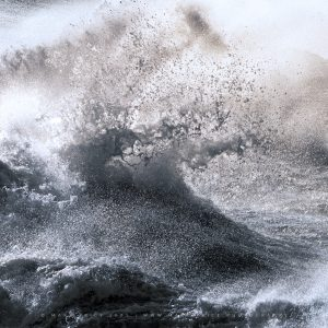 Insane swell and spray in a summer storm on. the coast of Dorset